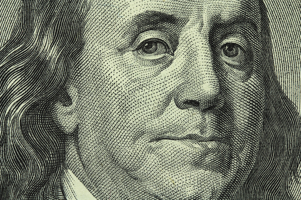 portrait of Benjamin Franklin on the hundred dollar bill closeup