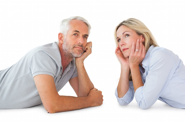Middle age couple thinking with white background, estate planning attorney