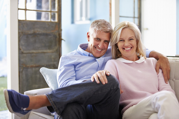 Mature couple smiling, tax planning with France Law Firm
