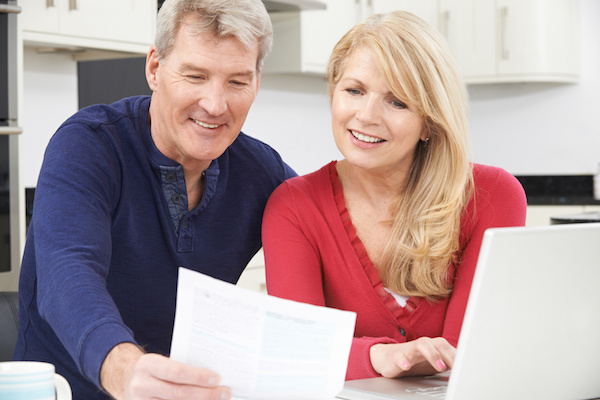 Smiling Mature Couple Reviewing Document, estate planning attorney, estate planning terms