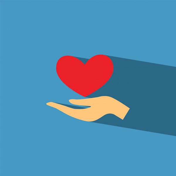 Hand giving heart, blue background, charitable giving tax advice, tax attorney